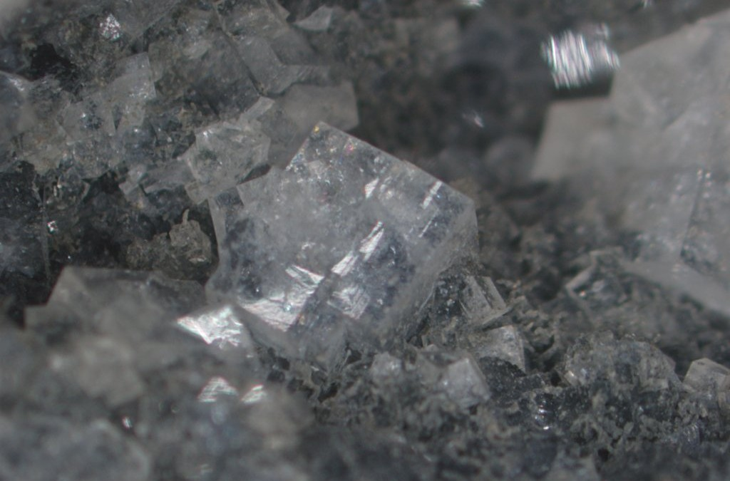 Image of chabazite filling a vesicle in basalt.